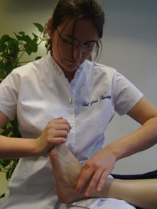 A Bowen Therapist doing an ankle move